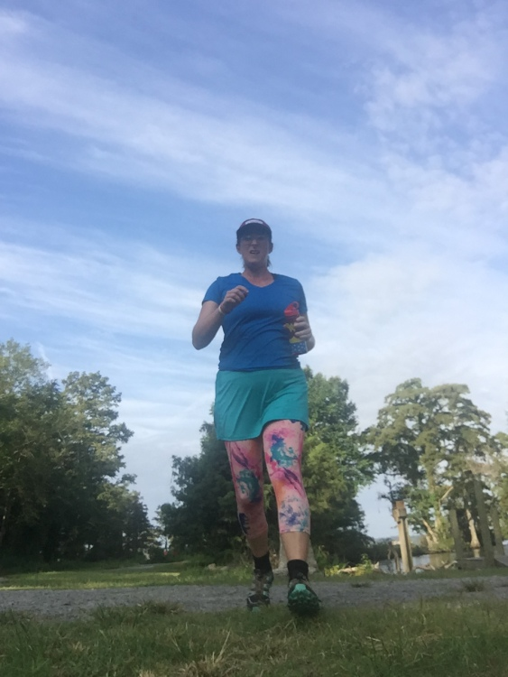 My racecation skirt is paired with my most colorful leggings. It has a zipper pocket in the back. I wear it at the beach and pool over my swimsuit sometimes. I'm also wearing one of the visors, which has a built in sweatband.
