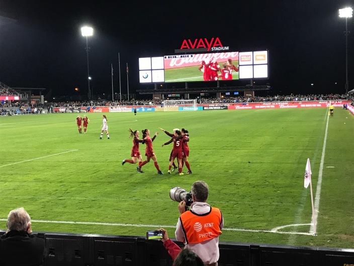 The US women's soccer team celebrates a goal by Carli Lloyd.