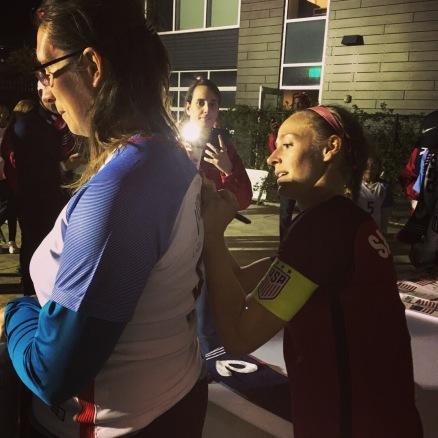 Getting an autograph from US women's team captain Becky Sauebrunn.