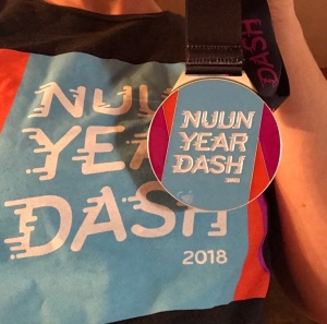 The Nuun Year Dash shirt and medal.