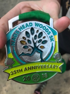 """The race medal. The """"tree"""" part is see through, like a stained glass window."""