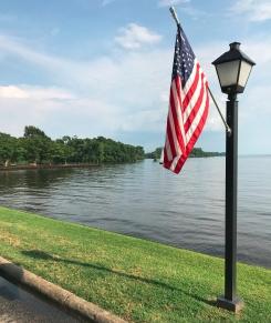 An American flag hangs from a lightpole along Edenton Bay in Edenton, NC.