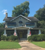 A home in Washington, North Carolina, has an American flag and state of North Carolina flag out front.