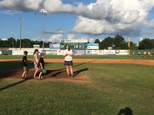 The kids and I waiting to throw out the first pitch at an Edenton Steamers game.