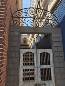 A gate bars entry into the upstairs of a downtown Manteo building.