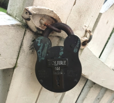 """This """"forged steel shackle"""" had four brass levers apparently. It keeps the Cupola House gardens safe from unwanted visitors."""