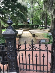 Many wrought iron fences are like the one pictured here, which serves as an entry way to an outdoor chapel.