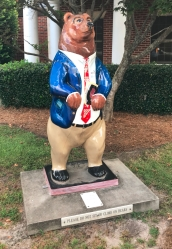 Several bear statues, like this one in front of an accounting office, are painted in various ways.